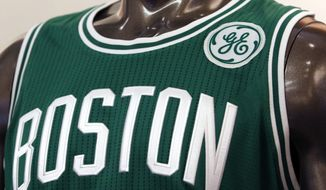 A General Electric logo patch is displayed on a Boston Celtics uniform during a news conference Wednesday, Jan. 25, 2017, at GE's headquarters in Boston. The Celtics reached an agreement with GE to put the company's logo on the team's uniform beginning next season. The Celtics are a charter member of the NBA basketball league and its most decorated franchise, with 17 championships. GE is in the process of moving its corporate headquarters from Connecticut to the Boston waterfront. (AP Photo/Bill Sikes)