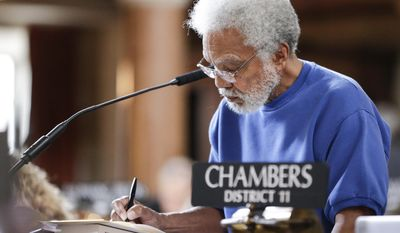 State Sen. Ernie Chambers, of Omaha, works in the Legislative Chamber in Lincoln, Neb., Wednesday, Jan. 25, 2017. The Legislature's Executive Board is set to hear arguments Wednesday over whether longtime Nebraska Sen. Ernie Chambers actually lives in the north Omaha district he represents. Chambers' critics have argued over the years that he actually lives in Bellevue, an Omaha suburb. Chambers has provided phone and utility bills and home ownership records showing he lives in Omaha. (AP Photo/Nati Harnik)