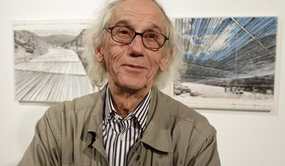 """FILE - In this Wednesday, Jan. 23, 2013 file photograph, artist Christo responds to questions during a show of sketches and photos of some of his in-progress works at the Metropolitan State University Center for Visual Art in Denver. Christo and his late wife, Jeanne-Claude, had won state and federal permits to build a project called """"Over the River,"""" which would have involved the suspension of nearly six miles of giant fabric panels from anchors and cables over parts of a 42-mile stretch of the Arkansas River next to U.S. Highway 50. On Wednesday, Jan. 25, 2017, Christo announced that he has abandoned plans to complete the project. (AP Photo/Brennan Linsley, file)"""