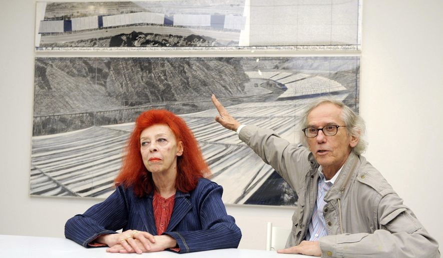 """FILE--In this  Feb. 11, 2009, file photograph, artist Christo, right, and his partner, Jeanne-Claude, are shown during a press conference for their exhibition """"Over the River, A Work in Progress"""" at the Fondation de lHermitage in Lausanne, Switzerland. The artists' then-current artwork in progress was called, """"Over The River,"""" which proposed the horizontal suspension of fabric panels in separate segments along a stretch above the Arkansas River in southern Colorado. On Wednesday, Jan. 25, 2017, Christo announced that he has abandoned his plans for the display over the Arkansas River. (Keystone/Dominic Favre via AP, file)"""