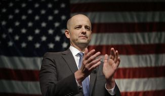 "FILE - This Nov. 8, 2016, file photo, conservative presidential candidate Evan McMullin speaks to his supporters during an election night watch party after Republican Donald Trump won Utah, in Salt Lake City. McMullin has created a group that he says will expand his ability to serve as a watchdog over President Donald Trump. McMullin on Wednesday, Jan. 25, 2017, announced the launch of the ""Stand Up Republic"" group.   (AP Photo/Rick Bowmer, File)"