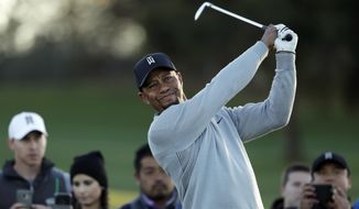 Tiger Woods watches his tee shot on the third hole of the north course during the Pro-Am event of the Farmers Insurance Open golf tournament Wednesday, Jan. 25, 2017, in San Diego. (AP Photo/Gregory Bull)