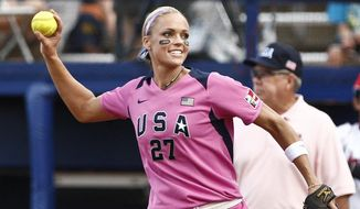 FILE - In this July 24, 2010, file photo, USA Team member and Olympic gold medalist Jennie Finch warms up before a game against Japan in a World Cup of Softball game in Oklahoma City. Finch is pitching youth softball this spring as an ambassador for Major League Baseball. The commissioner's office announced Wednesday, Jan. 25, 2017, that she'll join Cal Ripken Jr. and Ken Griffey Jr. as MLB youth ambassadors. (AP Photo/Alonzo Adams, File)