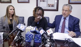 Attorney Howard M. Talenfeld, right, talks to reporters as Gina Alexis, left, mother of 14-year-old Nakia Venant, who livestreamed her suicide on Facebook over the weekend, weeps and Stacie J. Schmerling, left, looks on, during a news conference, Wednesday, Jan. 25, 2017, in Plantation, Fla. Nakia Venant's suicide is at least the third to be livestreamed nationally in the last month. (AP Photo/Alan Diaz)