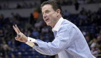Louisville head coach Rick Pitino shouts instructions to his team during the second half of an NCAA college basketball game against Pittsburgh, Tuesday, Jan. 24, 2017, in Pittsburgh. (AP Photo/Fred Vuich)