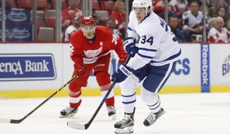 Toronto Maple Leafs center Auston Matthews (34) carries the puck against the Detroit Red Wings in the first period of an NHL hockey game Wednesday, Jan. 25, 2017, in Detroit. (AP Photo/Paul Sancya)