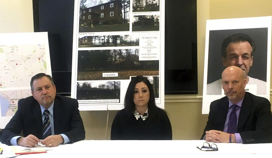 Attorneys Leander James, left, and Patrick Noaker, right, flanking client Lindsay Tornambe, center, at a news conference on Wednesday, Jan. 25, 2017, in Spokane, Wash. The attorneys and their client contend that members of a Minnesota religious sect have moved to Washington state and may be abusing children. (AP Photo/Nicholas K. Geranios)