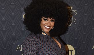 FILE - This Oct. 19, 2016 file photo shows Jill Scott at 2016 CMT Artists of the Year in Nashville, Tenn. Scott is following the footsteps of her idol Maya Angelou: The Grammy-winning singer is creating her own Hallmark Mahogany greeting card line. (Photo by Sanford Myers/Invision/AP, File)