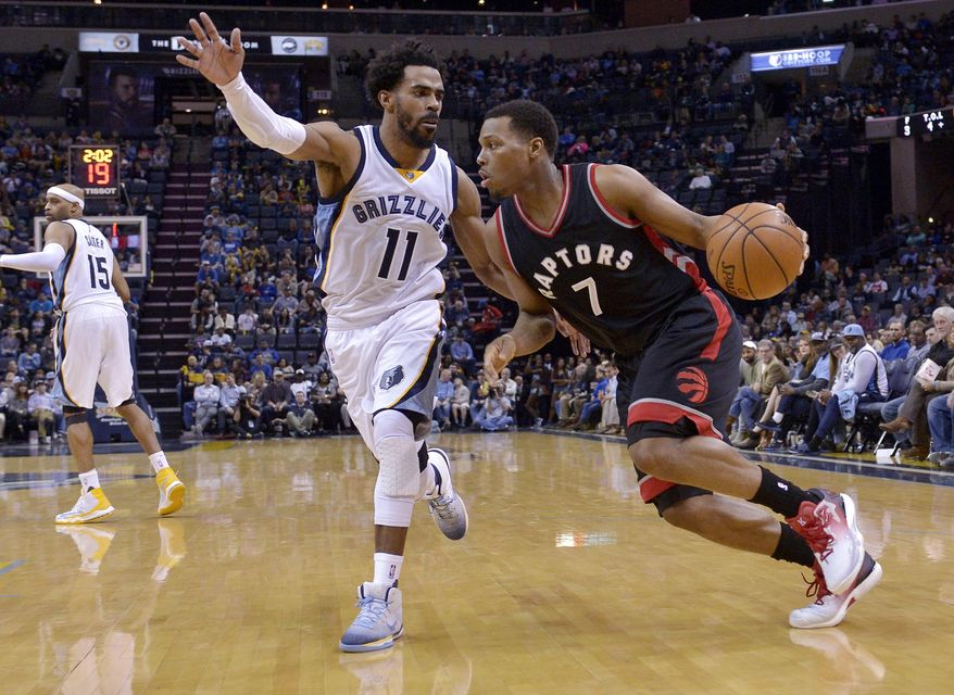 Memphis Grizzlies guard Mike Conley (11) tries to block Toronto Raptors guard Kyle Lowry (7) in the first half of an NBA basketball game, Wednesday, Jan. 25, 2017, in Memphis, Tenn. (AP Photo/Brandon Dill)