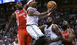 Boston Celtics guard Isaiah Thomas (4) drives to the basket past Houston Rockets forward Montrezl Harrell (5) during the first quarter of an NBA basketball game in Boston, Wednesday, Jan. 25, 2017. (AP Photo/Charles Krupa)