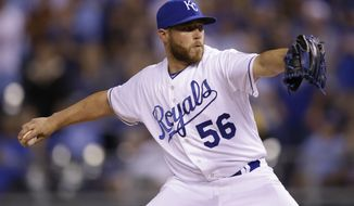 FILE - In this April 8, 2015, file photo, Kansas City Royals relief pitcher Greg Holland (56) throws during a baseball game against the Chicago White Sox at Kauffman Stadium in Kansas City, Mo. A person familiar with the deal tells The Associated Press that reliever Greg Holland has agreed to a contract with the Colorado Rockies The deal is pending a physical, the person said Wednesday, Jan. 25, 2017, speaking on condition of anonymity because the agreement was not announced. (AP Photo/Orlin Wagner, File)