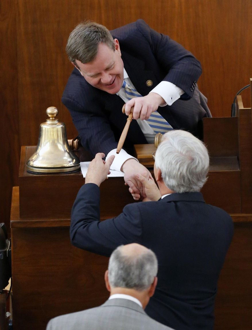 Republican House Speaker Tim Moore, top, passes out gavels to the various committee chairs as the N.C. General Assembly convenes at the Legislative Building in Raleigh, N.C., Wednesday, Jan. 25, 2017. (Chris Seward/The News & Observer via AP)