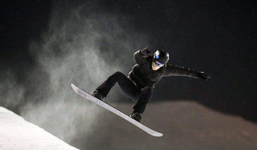FILE - In this Jan. 6, 2016, file photo, two-time Olympic snowboarder Shaun White trains at Canada Olympic Park in Calgary, Alberta. White turned 30 last fall, and anyone who tuned out after his stunning fail at the Olympics in Russia missed the start of a reboot that may feel more like a comeback story. Back at the Winter X Games this year, the two-time Olympic champion has refocused his business, his training and his fitness for a run at next year's games. (Jeff McIntosh/The Canadian Press via AP, File)