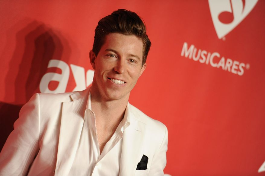 FILE - In this Friday, Feb. 6, 2015, file photo, Shaun White arrives at the 2015 MusiCares Person of the Year event at the Los Angeles Convention Center in Los Angeles. White turned 30 last fall, and anyone who tuned out after his stunning fail at the Olympics in Russia missed the start of a reboot that may feel more like a comeback story. Back at the Winter X Games this year, the two-time Olympic champion has refocused his business, his training and his fitness for a run at next year's games. (Photo by Richard Shotwell/Invision/AP, File)