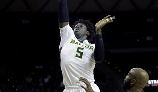Baylor forward Johnathan Motley (5) shoots against Texas Tech forward Anthony Livingston (21) during the first half of an NCAA college basketball game in Waco, Texas, Wednesday, Jan. 25, 2017. (AP Photo/LM Otero)