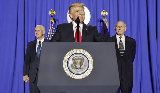 President Donald Trump, accompanied by Vice President Mike Pence, left, and Homeland Security Secretary John F. Kelly, pauses while speaking at the Homeland Security Department in Washington, Wednesday, Jan. 25, 2017. (AP Photo/Pablo Martinez Monsivais)