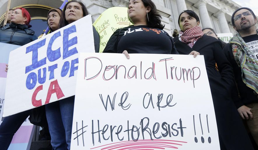 Protesters of President Trump's immigration policies defend San Francisco's sanctuary status. (Associated Press/File)
