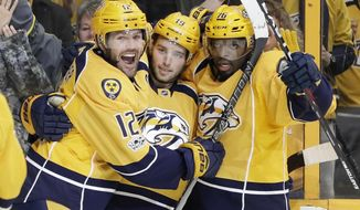 Nashville Predators center Calle Jarnkrok (19), of Sweden, celebrates with Mike Fisher (12) and P.K. Subban (76) after Jarnkrok scored a goal against the Columbus Blue Jackets during the second period of an NHL hockey game Thursday, Jan. 26, 2017, in Nashville, Tenn. (AP Photo/Mark Humphrey)