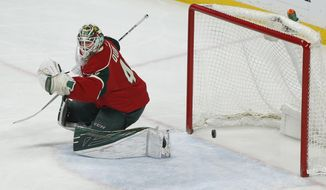 Minnesota Wild's goalie Devan Dubnyk blocks a goal-attempt by the St. Louis Blues in the first period of an NHL hockey game Thursday, Jan. 26, 2017, in St. Paul, Minn. (AP Photo/Stacy Bengs)
