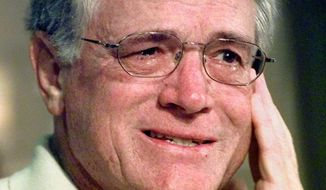 FILE - In this Dec. 18, 1998, file photo, Atlanta Falcons head coach Dan Reeves fights back tears as he speaks to reporters after being released from Piedmont Hospital in Atlanta, four days after having quadruple bypass surgery. These days, word of a coach making an emergency trip to the hospital has grown so common it could almost be part of the injury report.  (AP Photo/John Bazemore, File)