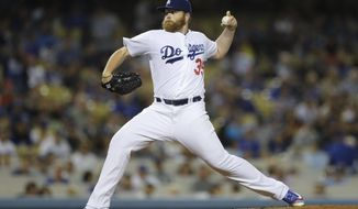 FILE - In this Sept. 22, 2016, file photo, Los Angeles Dodgers starting pitcher Brett Anderson throws against the Colorado Rockies during a baseball game in Los Angeles. The Chicago Cubs have finalized a one-year contract with Anderson. (AP Photo/Jae C. Hong, File)