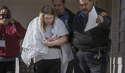 "FILE - In this Jan. 8, 2017 file photo, Sara Packer, center, handcuffed, the adoptive mother of Grace Packer, is led out of District Court in Newtown, Pa.,  by Pennsylvania Constables and taken into custody. Packer, whose teenage daughter's dismembered remains were found in the woods last fall, has been charged along with her boyfriend Jacob Sullivan with killing the girl in a ""rape-murder fantasy"" the couple shared, a prosecutor said. (Michael Bryant/The Philadelphia Inquirer via AP, File)"