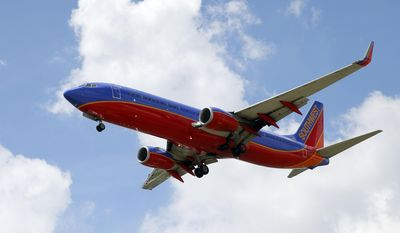 In this Friday, Aug. 26, 2016, photo, a Southwest Airlines jet makes its approach to Dallas Love Field airport, in Dallas. Southwest Airlines Co. reports financial results Thursday, Jan. 26, 2017. (AP Photo/Tony Gutierrez)