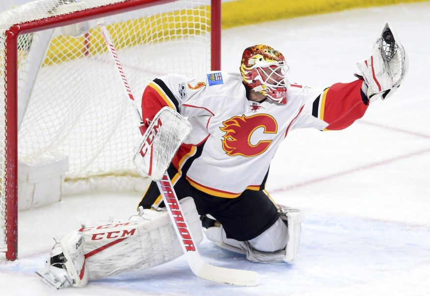 Calgary Flames goalie Brian Elliott makes a glove save while atainst the Ottawa Senators during the first period of an NHL hockey game Thursday, Jan. 26, 2017, in Ottawa, Ontario. ean Kilpatrick/The Canadian Press via AP)