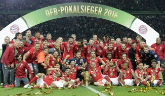 FILE- In this Saturday, May 21, 2016 file photo, Bayern Munich players celebrate after winning the German soccer cup final match between Borussia Dortmund and FC Bayern Munich in Berlin, Germany. The Bundesliga's economic strength keeps on growing. Bundesliga CEO Christian Seifert says the 18 teams in Germany's top division broke the 3 billion euro mark in revenue last season. (AP Photo/Markus Schreiber, File)