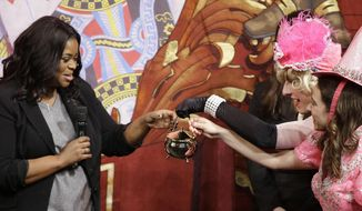 Actress Octavia Spencer is presented with the Pudding Pot by members of the Hasty Pudding Theatricals after being presented with the annual Woman of the Year Pudding Pot Award at Farkas Hall Thursday, Jan. 26, 2017, in Cambridge, Mass. (AP Photo/Stephan Savoia)