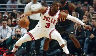 Chicago Bulls guard Dwyane Wade, left, is defended by Atlanta Hawks guard Tim Hardaway Jr., right, during the second half of an NBA basketball game, Wednesday, Jan. 25, 2017, in Chicago. The Hawks won 119-114. (AP Photo/Kamil Krzaczynski)