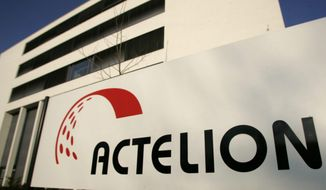 FILE - This Thursday, Feb. 22, 2007, file photo shows the headquarters of biopharmaceutical company Actelion, in Allschwil, Switzerland. In a deal announced Thursday, Jan. 26, 2017, Johnson & Johnson is buying Swiss pharmaceutical Actelion in a $30 billion deal that will boost its treatments for life-threatening high blood pressure conditions. (Georgios Kefalas/Keystone via AP, File)