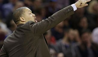 Cleveland Cavaliers coach Tyronn Lue yells to players during the first half of the team's NBA basketball game against the Sacramento Kings, Wednesday, Jan. 25, 2017, in Cleveland. The Kings won 116-112 in overtime. (AP Photo/Tony Dejak)