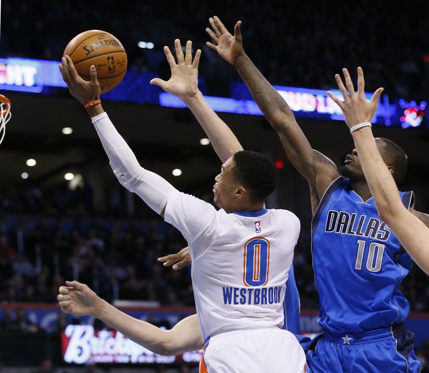 Oklahoma City Thunder guard Russell Westbrook (0) shoots in front of Dallas Mavericks forward Dorian Finney-Smith (10) during the third quarter of an NBA basketball game in Oklahoma City, Thursday, Jan. 26, 2017. Oklahoma City won 109-98. (AP Photo/Sue Ogrocki)