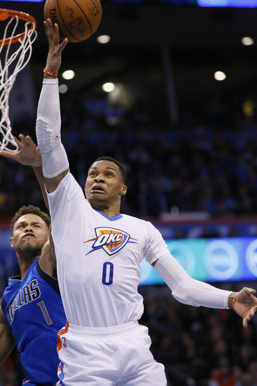 Oklahoma City Thunder guard Russell Westbrook (0) shoots in front of Dallas Mavericks guard Justin Anderson during the fourth quarter of an NBA basketball game in Oklahoma City, Thursday, Jan. 26, 2017. Oklahoma City won 109-98. (AP Photo/Sue Ogrocki)