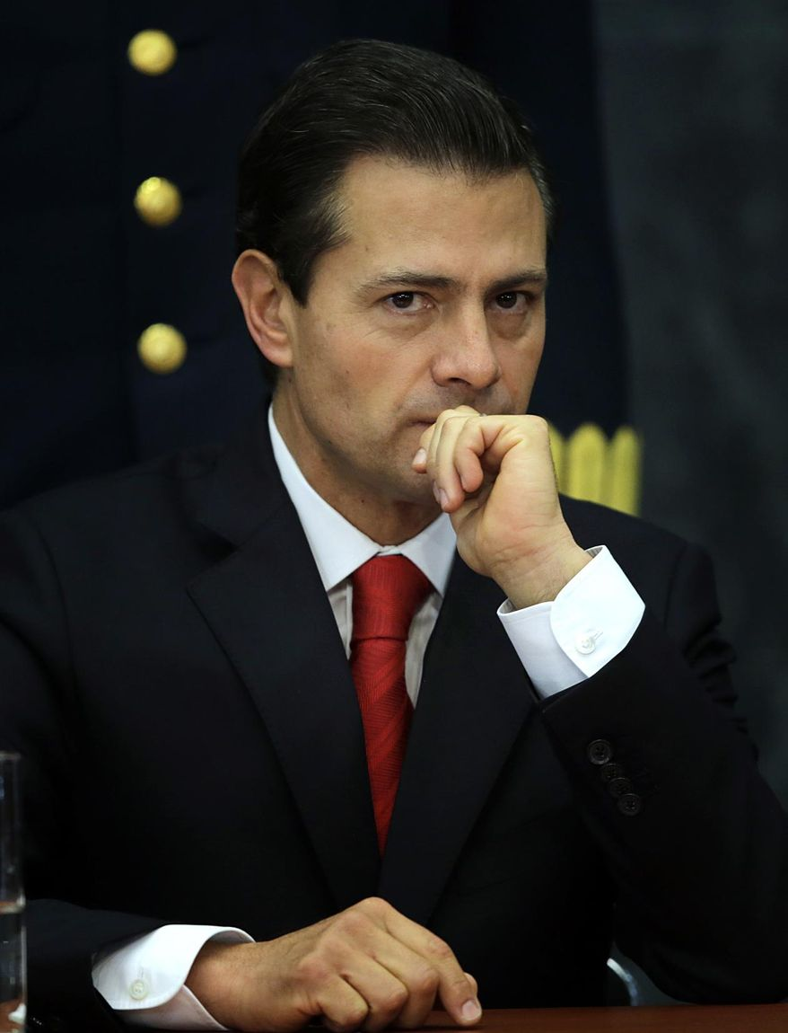 Mexico's President Enrique Pena Nieto pauses during a press conference at Los Pinos presidential residence in Mexico City, Monday, Jan. 23, 2017. Pena Nieto said Monday that Mexico's attitude towards the Donald Trump administration should not be aggressive or biased, but one of dialogue. (AP Photo/Marco Ugarte)