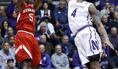 Nebraska guard Glynn Watson Jr., left, shoots against Northwestern forward Vic Law during the first half of an NCAA college basketball game Thursday, Jan. 26, 2017, in Evanston, Ill. (AP Photo/Nam Y. Huh)