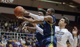 North Carolina Wilmington's Devontae Cacok, from left, Chris Flemmings and James Madison senior Ivan Lukic all go for a rebound in first half of the game Thursday, Jan. 26, 2017 in Harrisonburg, Va. The Seahawks won 87-76. (Nikki Fox/Daily News-Record via AP)