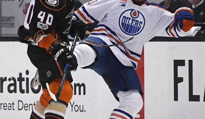 Anaheim Ducks right wing Jared Boll, left, and Edmonton Oilers left wing Matt Hendricks collide during the first period of an NHL hockey game, Wednesday, Jan. 25, 2017, in Anaheim, Calif. (AP Photo/Mark J. Terrill)