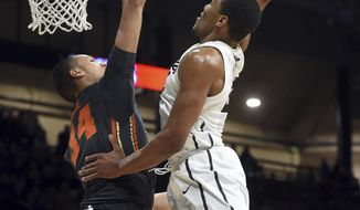 Colorado's George King dunks on Oregon State's Ben Kone during the first half of an NCAA college basketball game Thursday, Jan. 26, 2017, in Boulder, Colo. (Cliff Grassmick/Daily Camera via AP)
