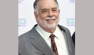 """FILE - This April 29, 2016 file photo shows honoree Francis Ford Coppola at a handprint and footprint ceremony at the TCL Chinese Theater in Los Angeles. The director has launched a Kickstarter campaign to raise $900,000 for what he says will be an """"immersive, psychedelic horror roll-playing game"""" based on his classic 1979 Vietnam War film, """" Apocalypse Now."""" (Photo by Chris Pizzello/Invision/AP, File)"""