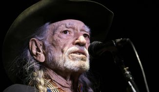 FILE- In this Jan. 7, 2017 file photo, Willie Nelson performs in Nashville, Tenn. Nelson is canceling two Las Vegas shows this weekend due to illness. Nelson's publicist, said Thursday that Nelson has a bad cold and won't play Saturday Jan. 28 or Sunday Jan. 29. He plans to play the remaining three shows, Feb. 1, 3 and 4, at The Venetian resort on the Las Vegas Strip. (AP Photo/Mark Humphrey,File)