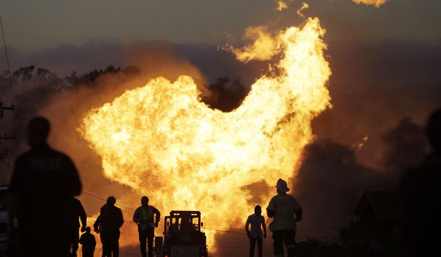 FILE - In this Sept. 9, 2010 file photo, a massive fire roars through a neighborhood in San Bruno, Calif. California's largest utility must pay a $3 million fine and run thousands of TV commercials publicizing its pipeline safety violations as punishment for its criminal convictions in a deadly natural gas explosion in the San Francisco Bay Area. U.S. District Judge Thelton Henderson sentenced Pacific Gas & Electric Co. on Thursday, Jan. 26, 2017. In addition to the fine and advertising requirement, he required PG&E employees to perform 10,000 hours of community service. (AP Photo/Paul Sakuma, File)