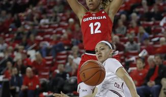 South Carolina guard Bianca Cuevas-Moore (1) loses the ball as she falls while driving against Georgia guard Haley Clark (12) in the second half of an NCAA college basketball game Thursday, Jan. 26, 2017, in Athens, Ga. South Carolina won 62-44. (AP Photo/John Bazemore)