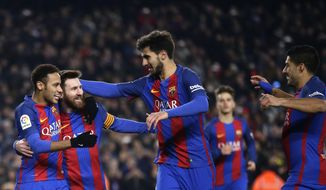 FC Barcelona's Lionel Messi, second left, celebrates with team mates after scoring a penalty during Copa del Rey, quarter final, second leg, soccer match between FC Barcelona and Real Sociedad at the Camp Nou in Barcelona, Spain, Thursday, Jan. 26, 2017. (AP Photo/Manu Fernandez)