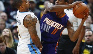 Denver Nuggets guard Jameer Nelson, left, defends as Phoenix Suns guard Brandon Knight looks to pass the ball in the first half of an NBA basketball game Thursday, Jan. 26, 2017, in Denver. (AP Photo/David Zalubowski)