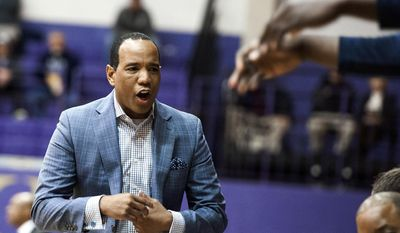 UNC Wilmington coach Kevin Keatts reacts to a play during the team's NCAA college basketball game against James Madison on Thursday, Jan. 26, 2017, in Harrisonburg, Va. (Nikki Fox/Daily News-Record via AP)