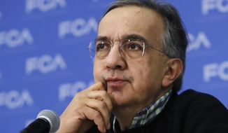 "FILE - In this file photo dated Monday, Jan. 9, 2017, Fiat Chrysler CEO Sergio Marchionne during a briefing at the North American International Auto show, in Detroit, USA.  Marchionne said Thursday Jan. 26, 2017, in a conference call that discussions are ""proceeding well"" with  U.S. environmental authorities over accusations that the company failed to disclose software that let vehicles emit more pollution than allowed. (AP Photo/Carlos Osorio, File)"