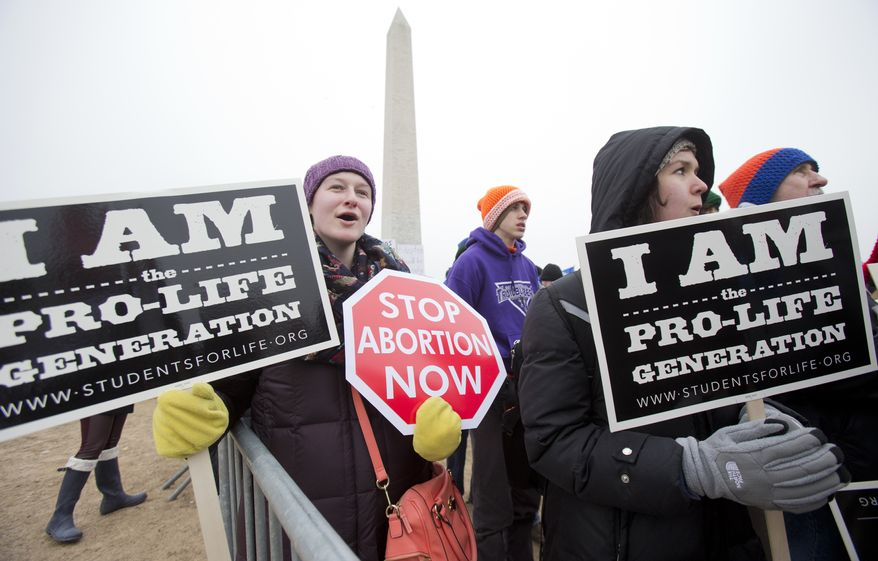 "In this Friday, Jan. 22, 2016, file photo, Michelle Doyle, left, joins the March for Life 2016 rally, commemorating the anniversary of 1973 ""Roe v. Wade"" U.S. Supreme Court decision legalizing abortion in Washington. The annual rally will be held Friday, Jan. 27, 2017, on the National Mall in the nations capital. (AP Photo/Manuel Balce Ceneta, File)"