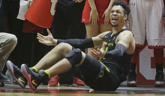 Oregon forward Dillon Brooks reacts after falling to the court during the second half of an NCAA college basketball game against Utah Thursday, Jan. 26, 2017, in Salt Lake City. Oregon won 73-67. (AP Photo/Rick Bowmer)